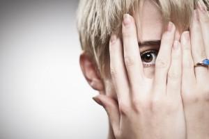 Beautiful Young Caucasian Woman Peeking Through Fingers