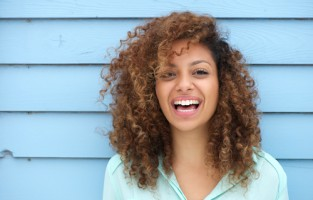 Cheerful young african woman smiling